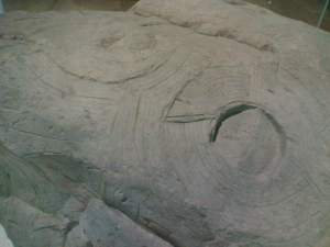 Rock carved with knotwork motif resembling the Celtic knot, perhaps symbolizing the World Egg (exhibit at Tokyo National Museum)