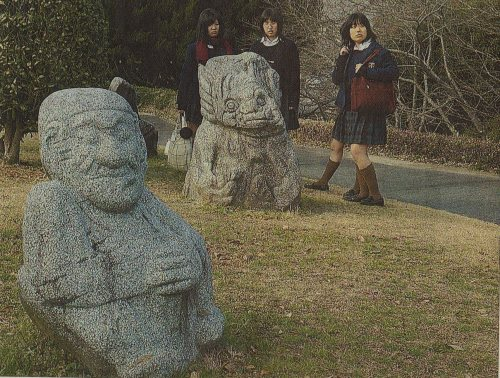 High school studnets from Tokyo gather around a replica of a stone statue of an ape at the Asuka Historical Museum (Daily Yomiuri photo)