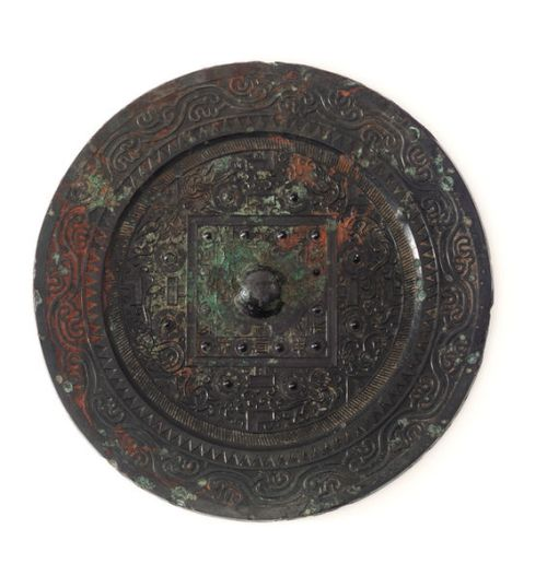 A TLV mirror dating from the Eastern Han Dynasty, 1st-2nd century AD.