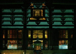 The Nara Buddha partially seen through a window of the Great Buddha Hall, Todaiji