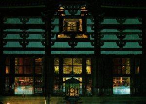 The Nara Buddha partially seen through a window of the Great Buddha Hall, Todaiji