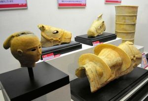 "These ""haniwa"" clay figurines and sculptures, on exhibit at the Edo-Tokyo Museum, were excavated by the Imperial Household Agency. The figurine shaped like a human head, foreground, is from the Daisen burial mound in Sakai, Osaka Prefecture. (Kazuaki Owaki)"