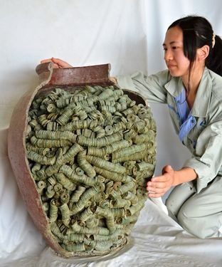 The pot containing more than 40,000 coins dating back to around the 15th century that was recently unearthed in Kyoto (Tsuyoshi Sato)