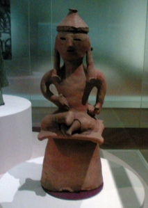 Haniwa terracotta figurine of a man sitting cross-legged