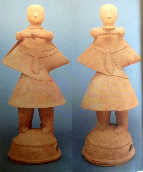 Haniwa terracotta figurines of a pair of miko maidens paying their respects before the court