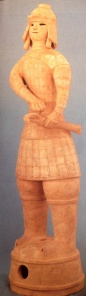 Haniwa figurine of a warrior in a pose with hand on his sword
